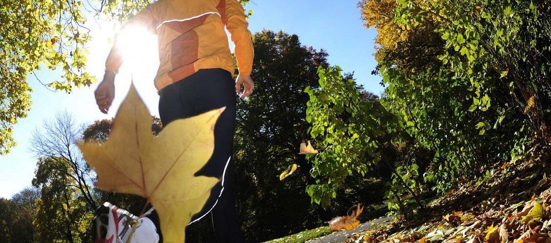 Woman Running in Autumn